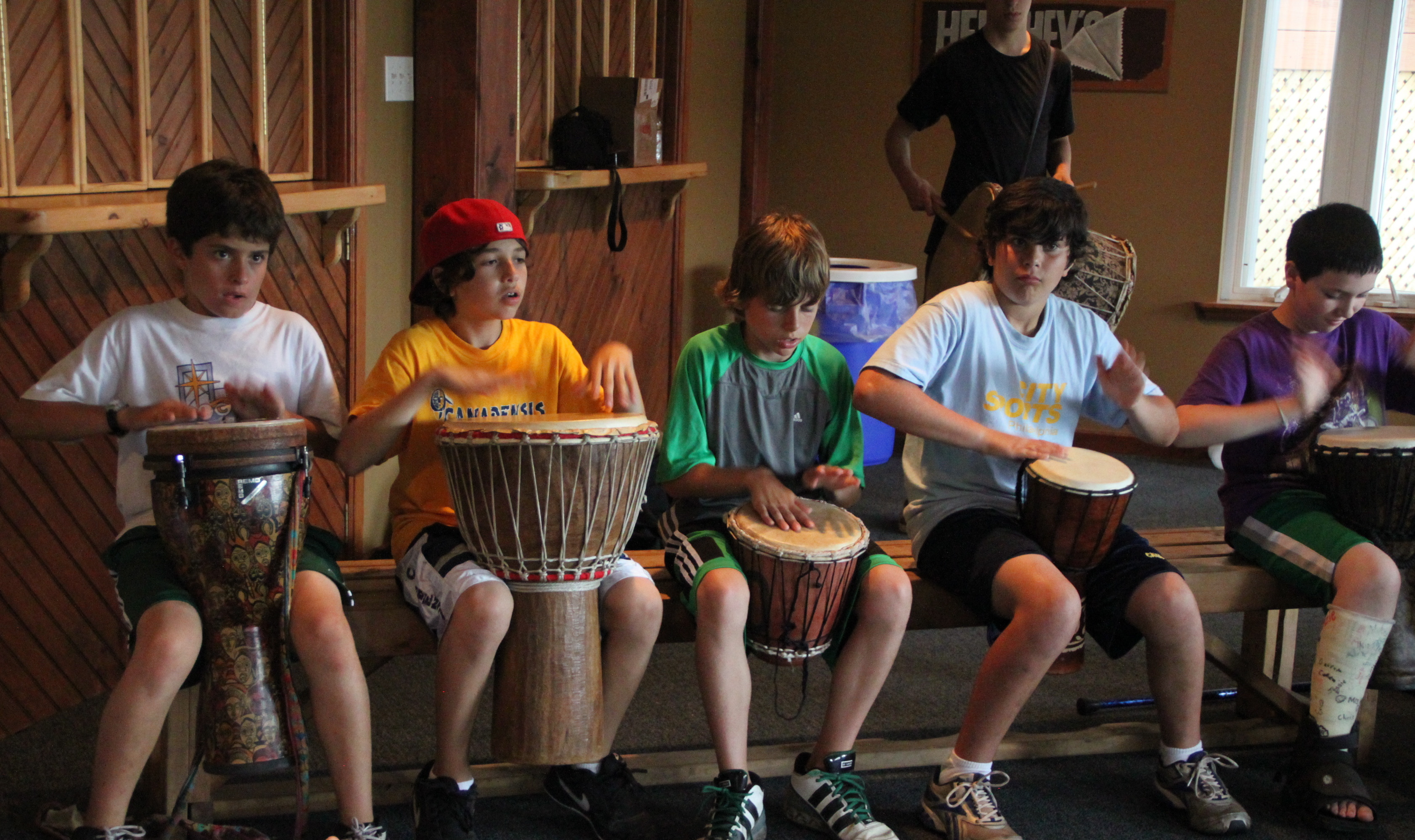 Campers drumming inside