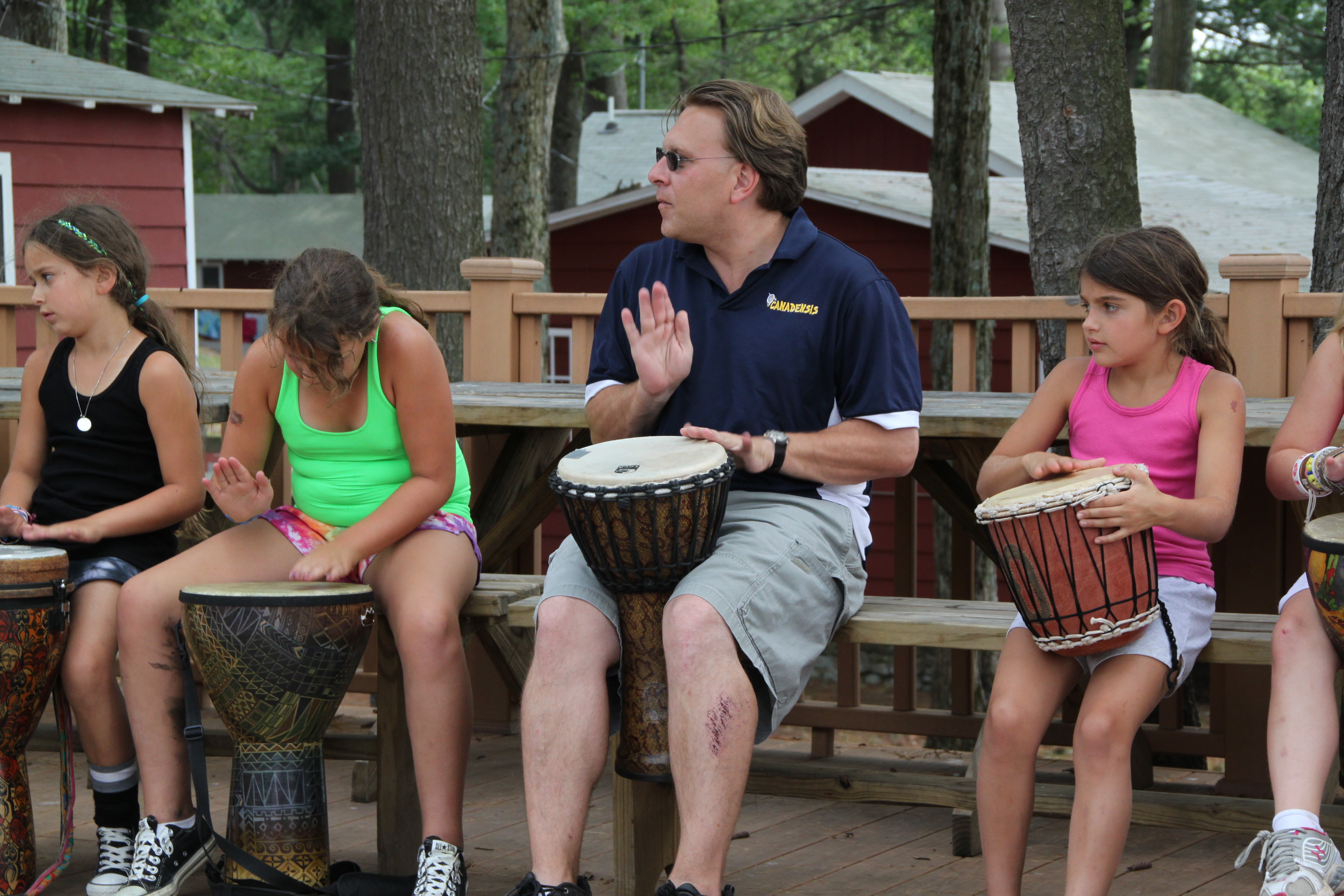 Brian Krug drumming with campers